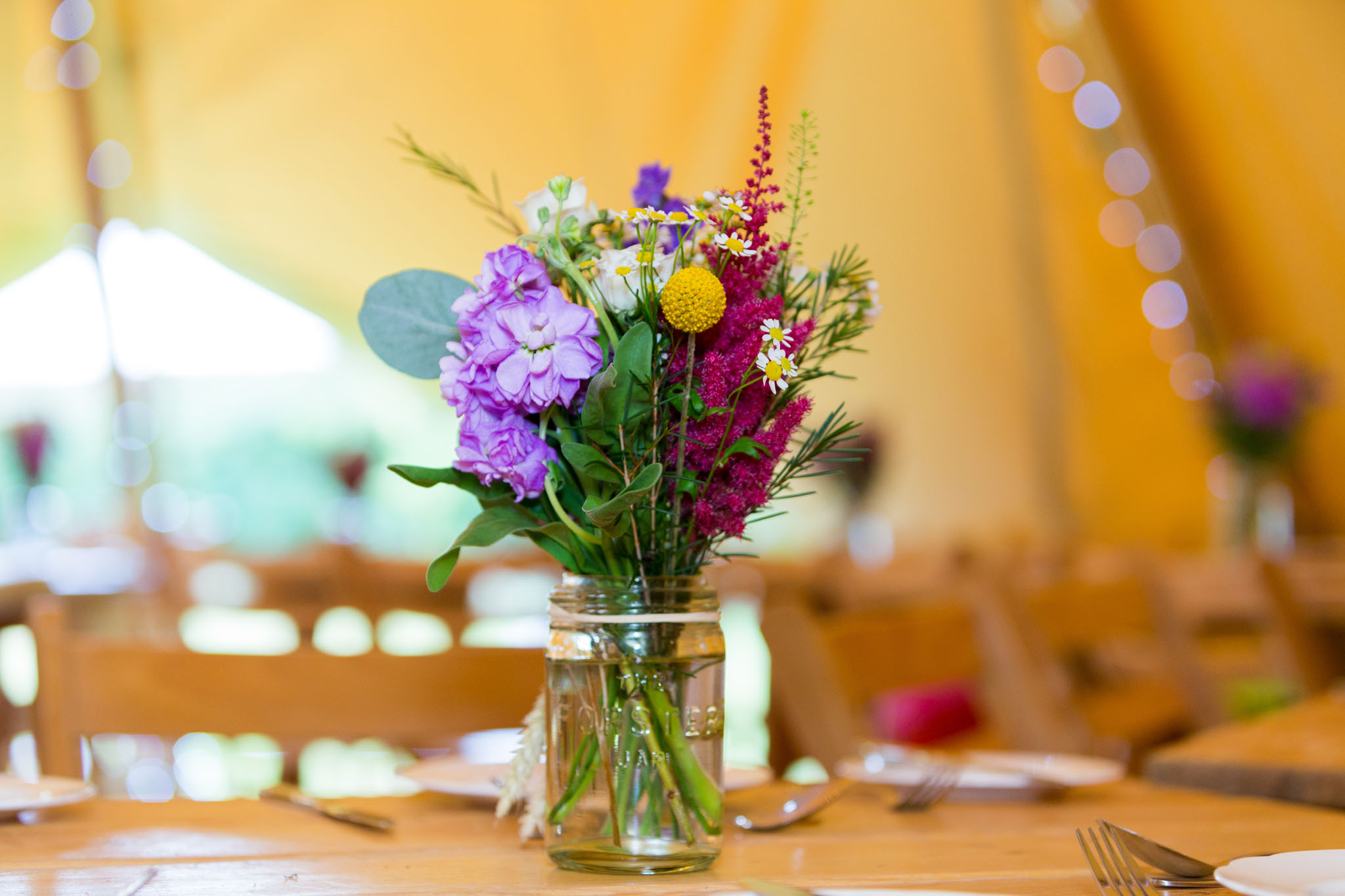 Table decorations at a family celebration in a teepee in Crewe Green in Cheshire