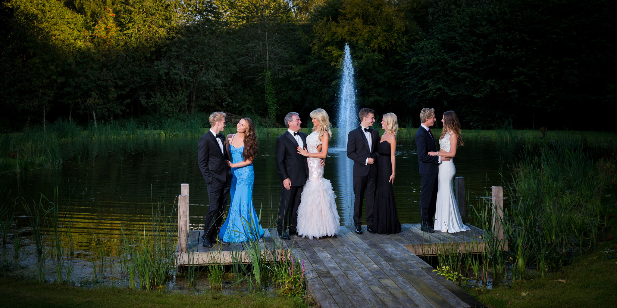 A formal family portrait photograph to mark a 50th birthday in Cheshire