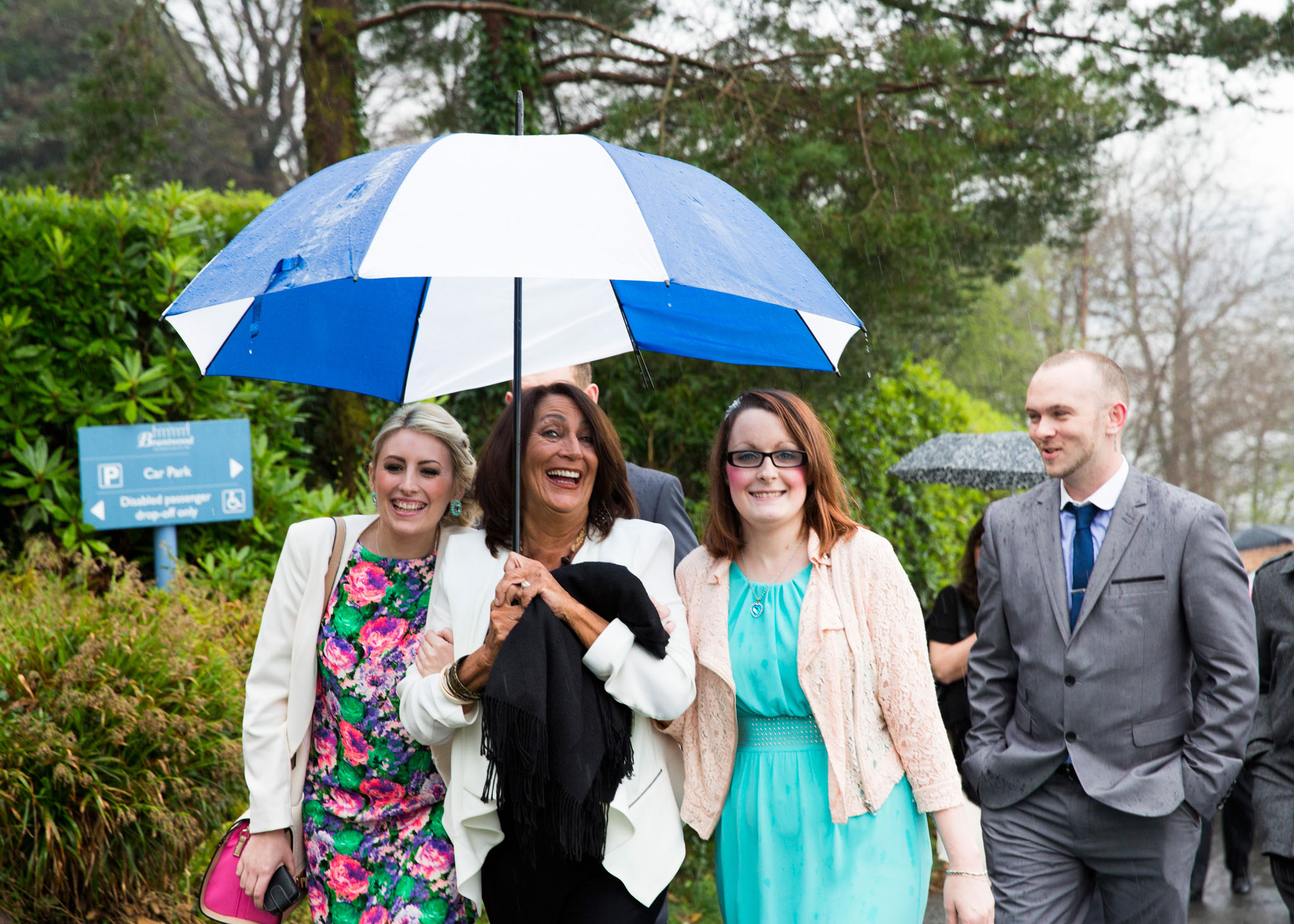 The rain doesn't stop people having fun at a family celebration at Coniston in the Lake District