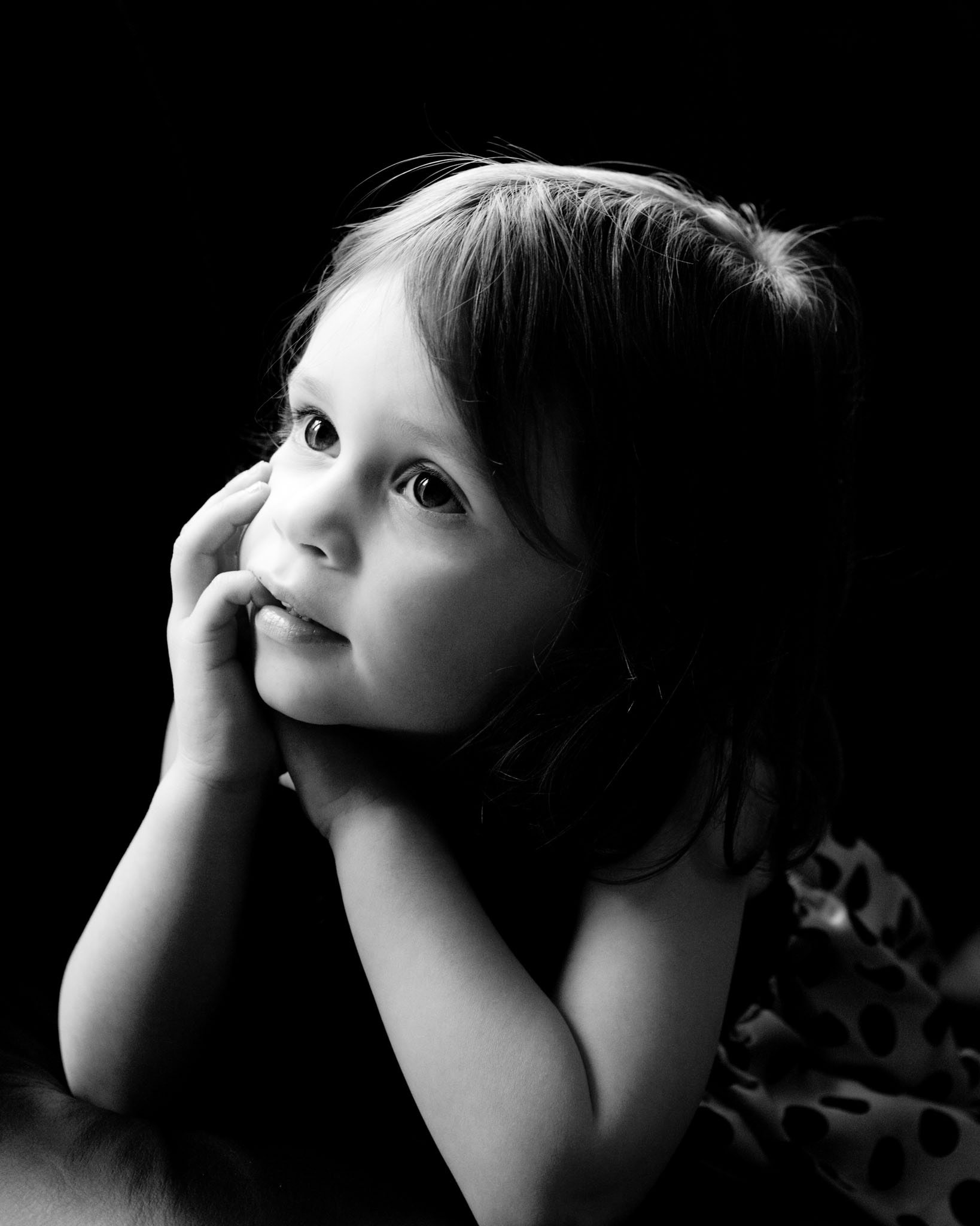 Little girl photographed in window light by cheshire family photographer Andrew Collier