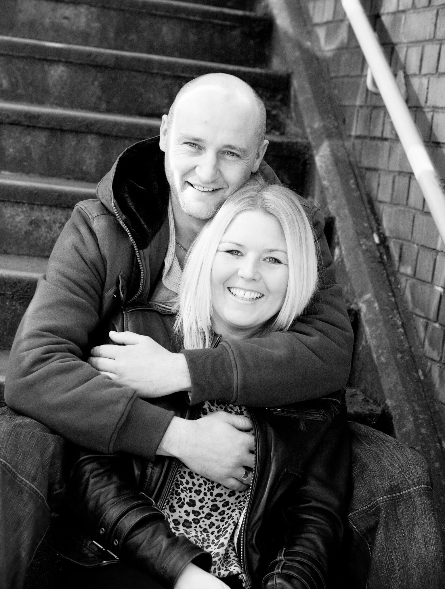 A couples portrait by Deansgate Station, Manchester by Cheshire lifestyle photographer Andrew Collier Photography