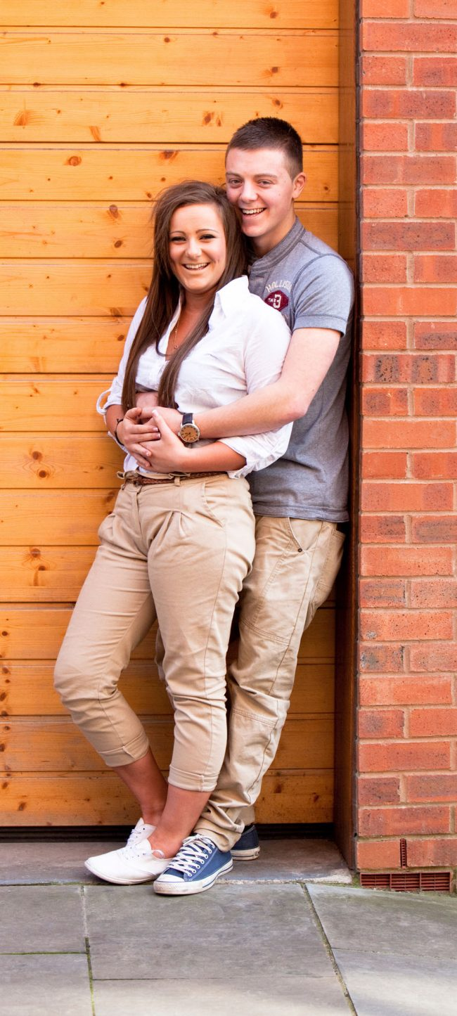 A portrait of a young couple near Liverpool Road in Manchester by Cheshire lifestyle photographer Andrew Collier Photography
