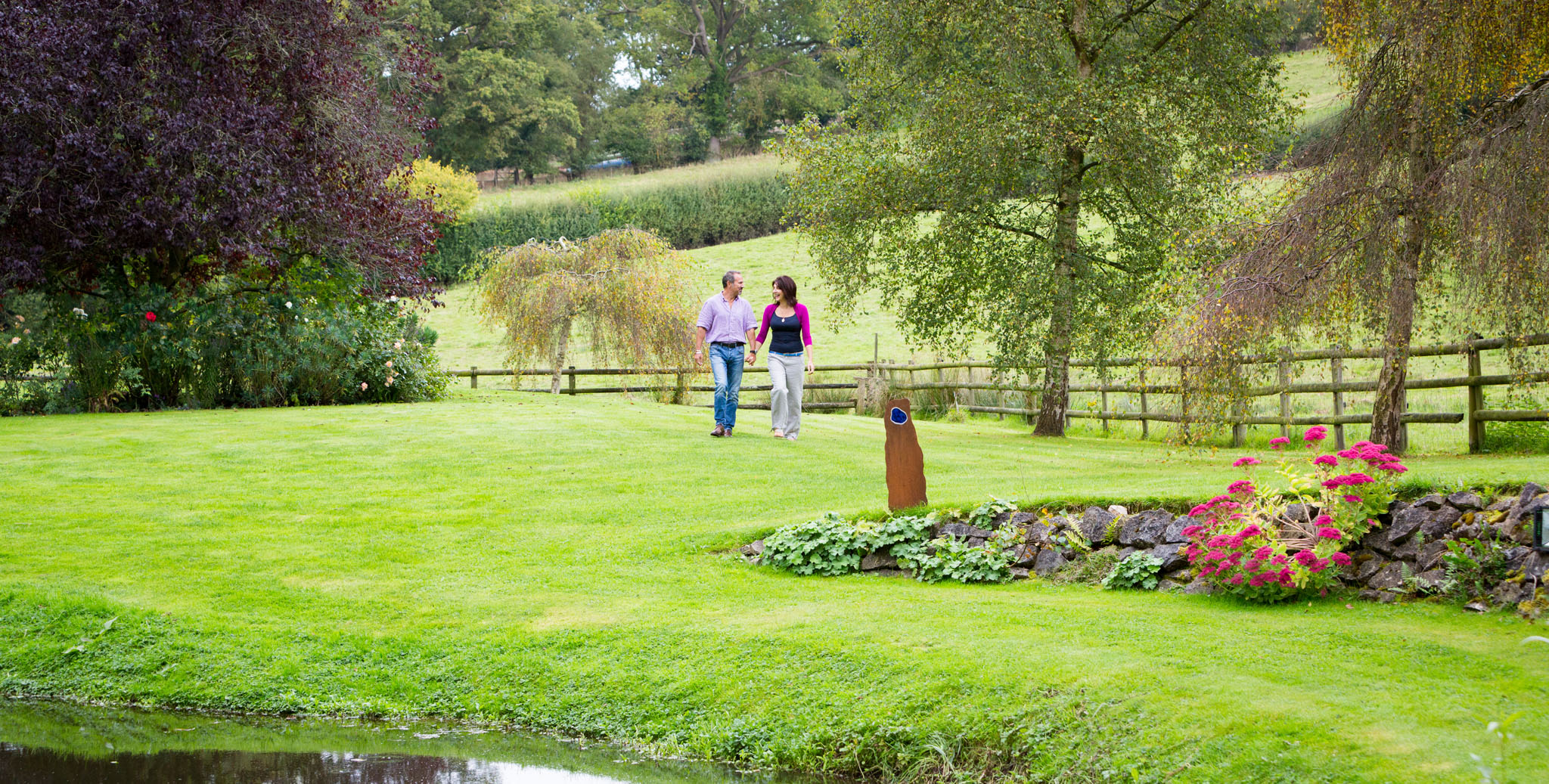 Couple walking in their garden on the Cheshire/wales border by Cheshire lifestyle photographer Andrew Collier Photography