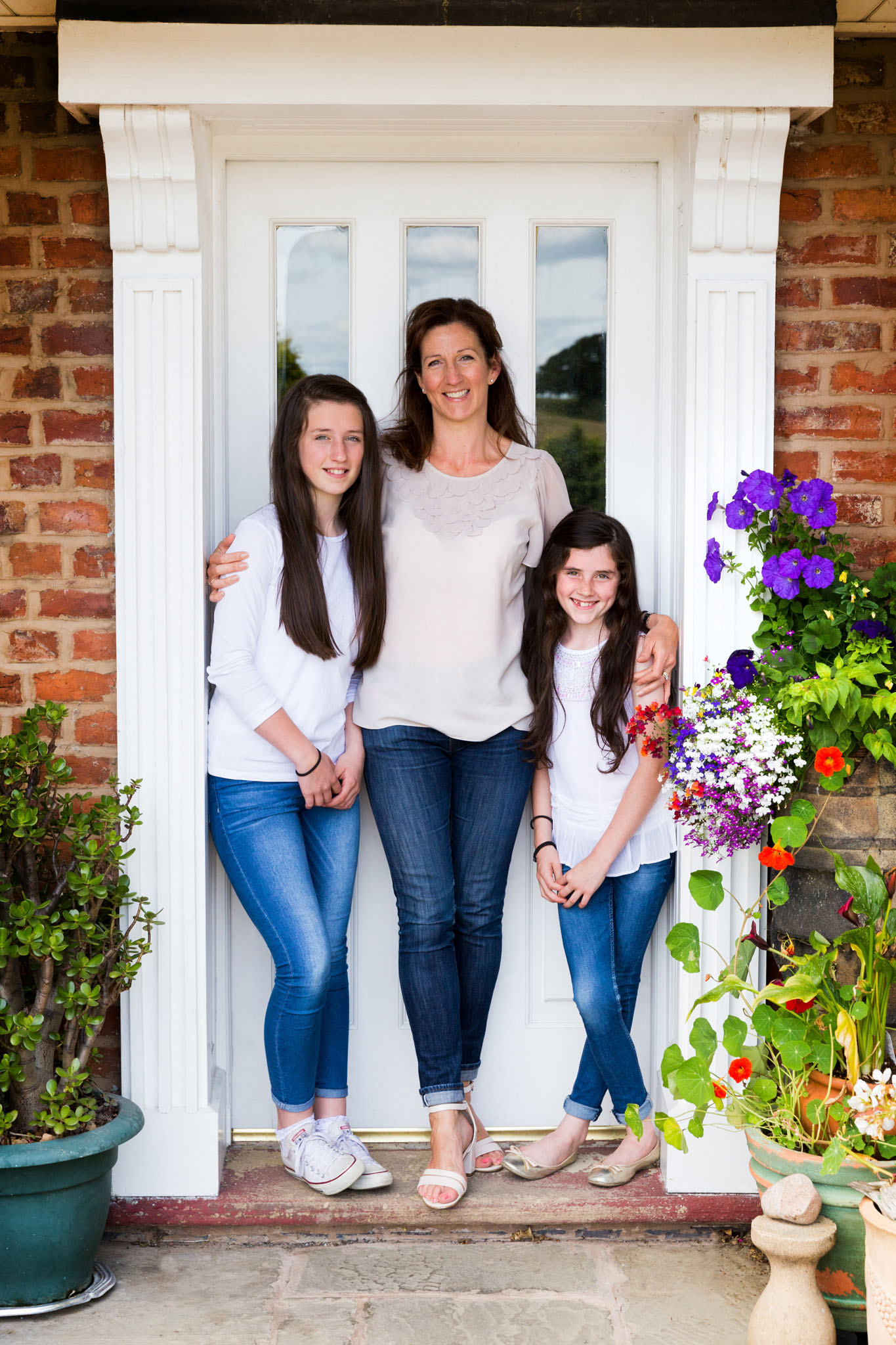 Family portrait photography of a mother and daughters near Altrincham, Cheshire