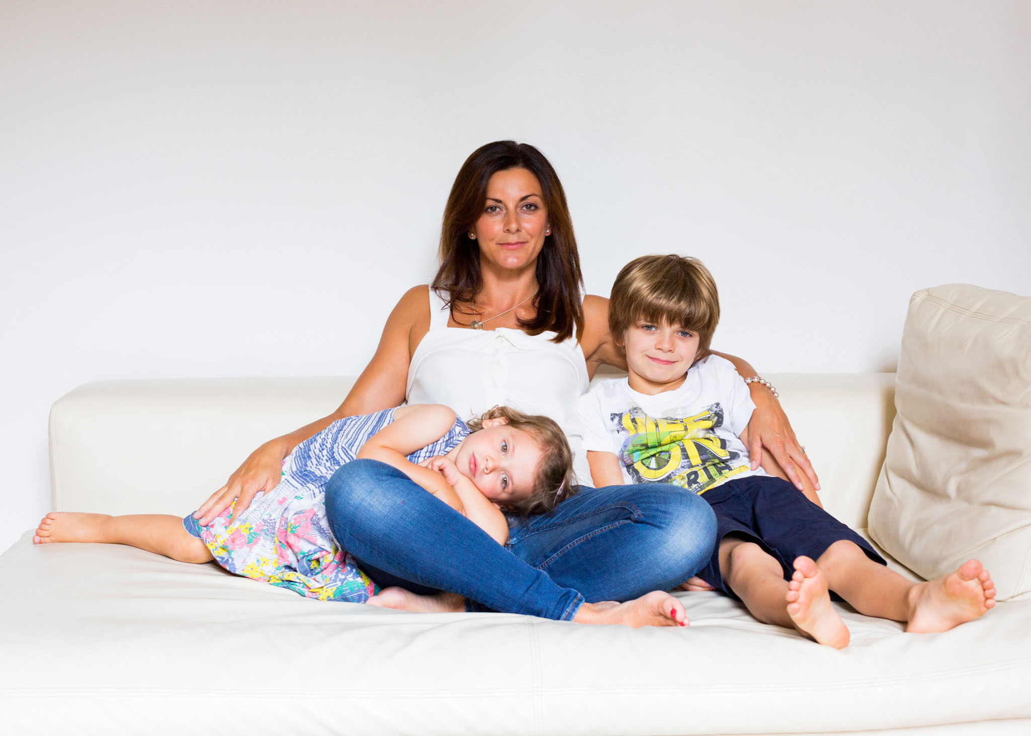 Lifestyle family portrait photography of a young family on the sofa in Didsbury, Manchester