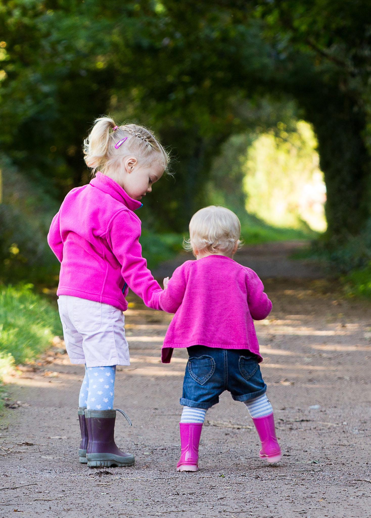 Lifestyle family portrait photography of young sisters out for a walk in Lymm, Cheshire