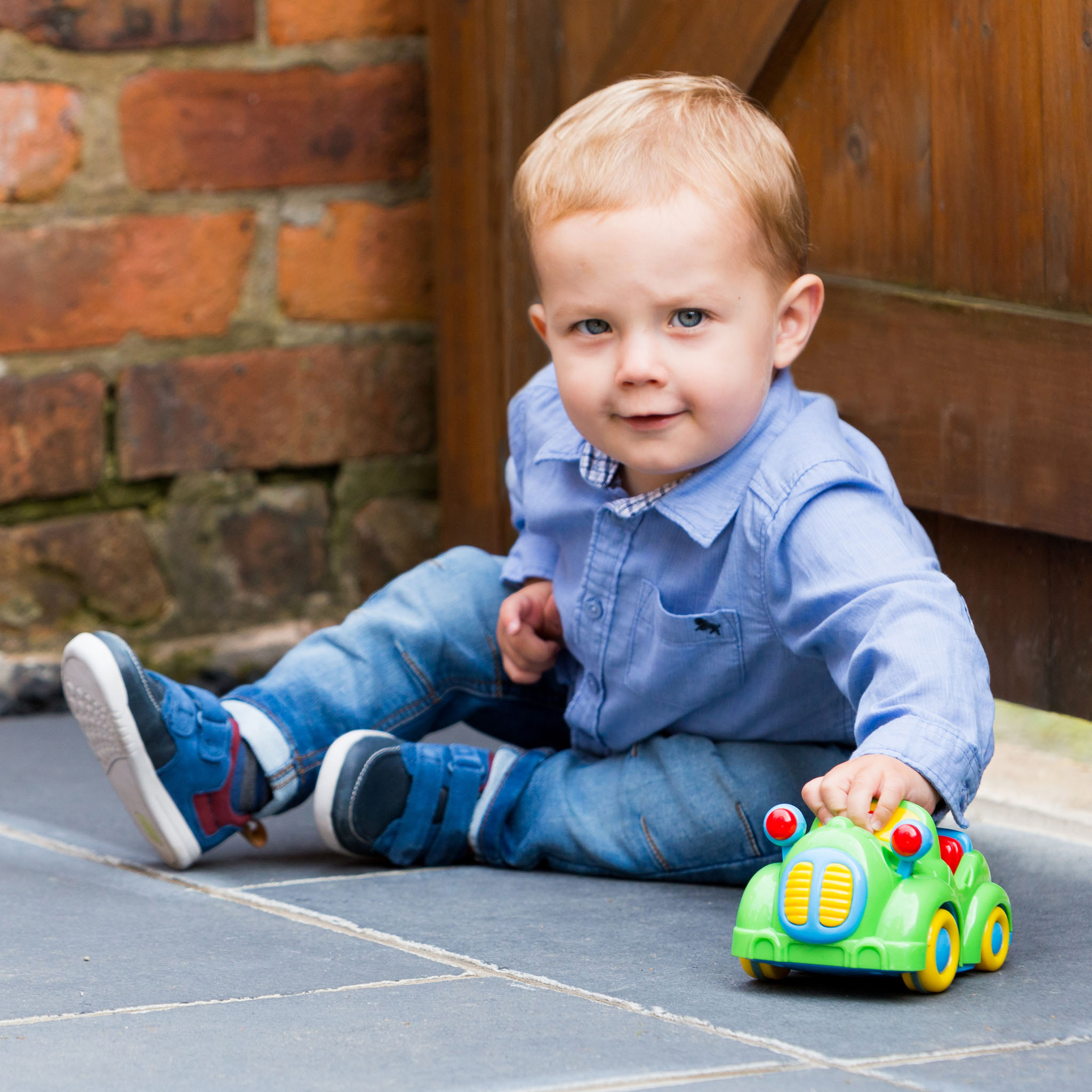 Lifestyle family portrait photography of a toddler playing in Urmston, Manchester