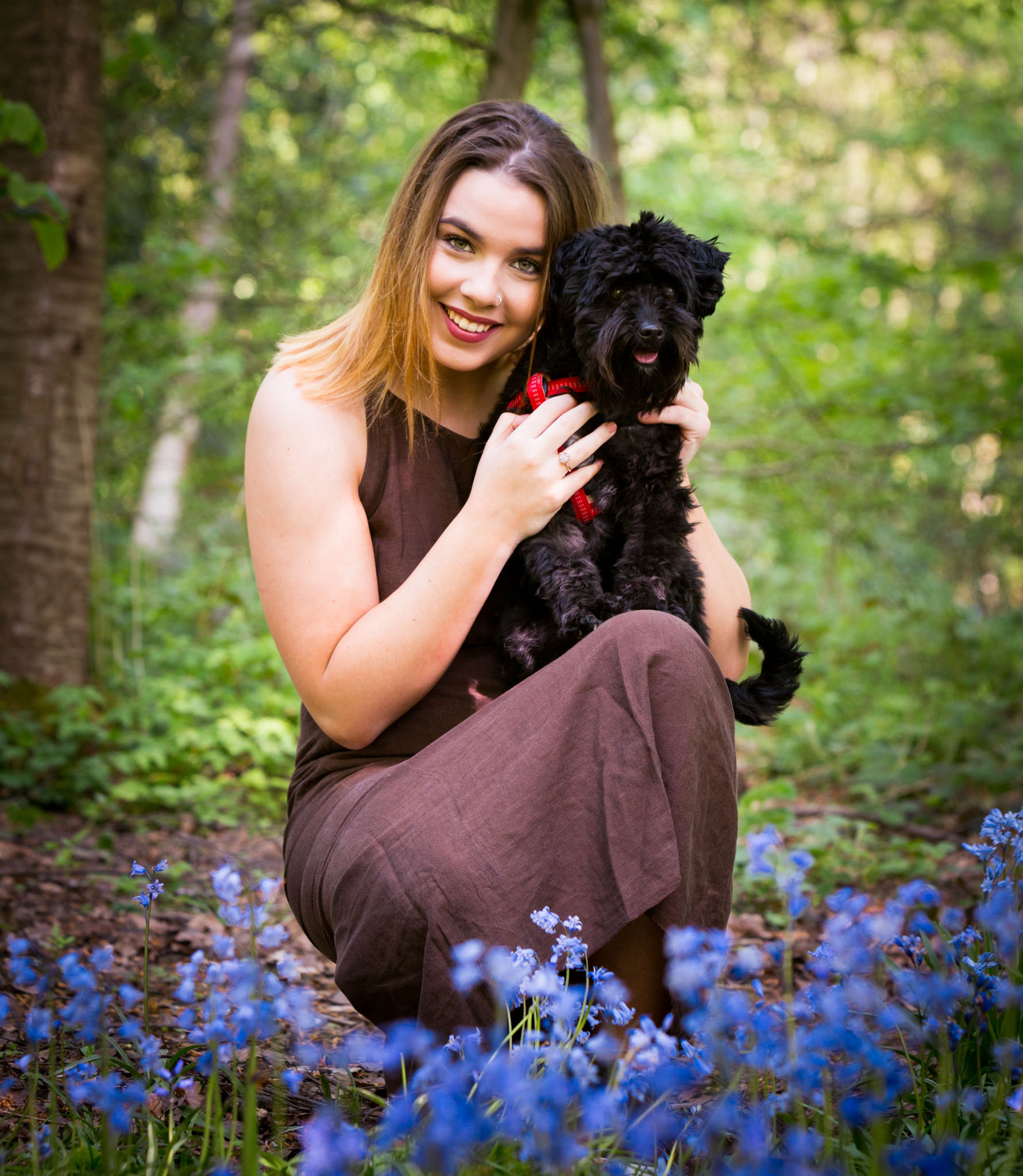 A portrait of a young dog and her owner in Lymm, Cheshire