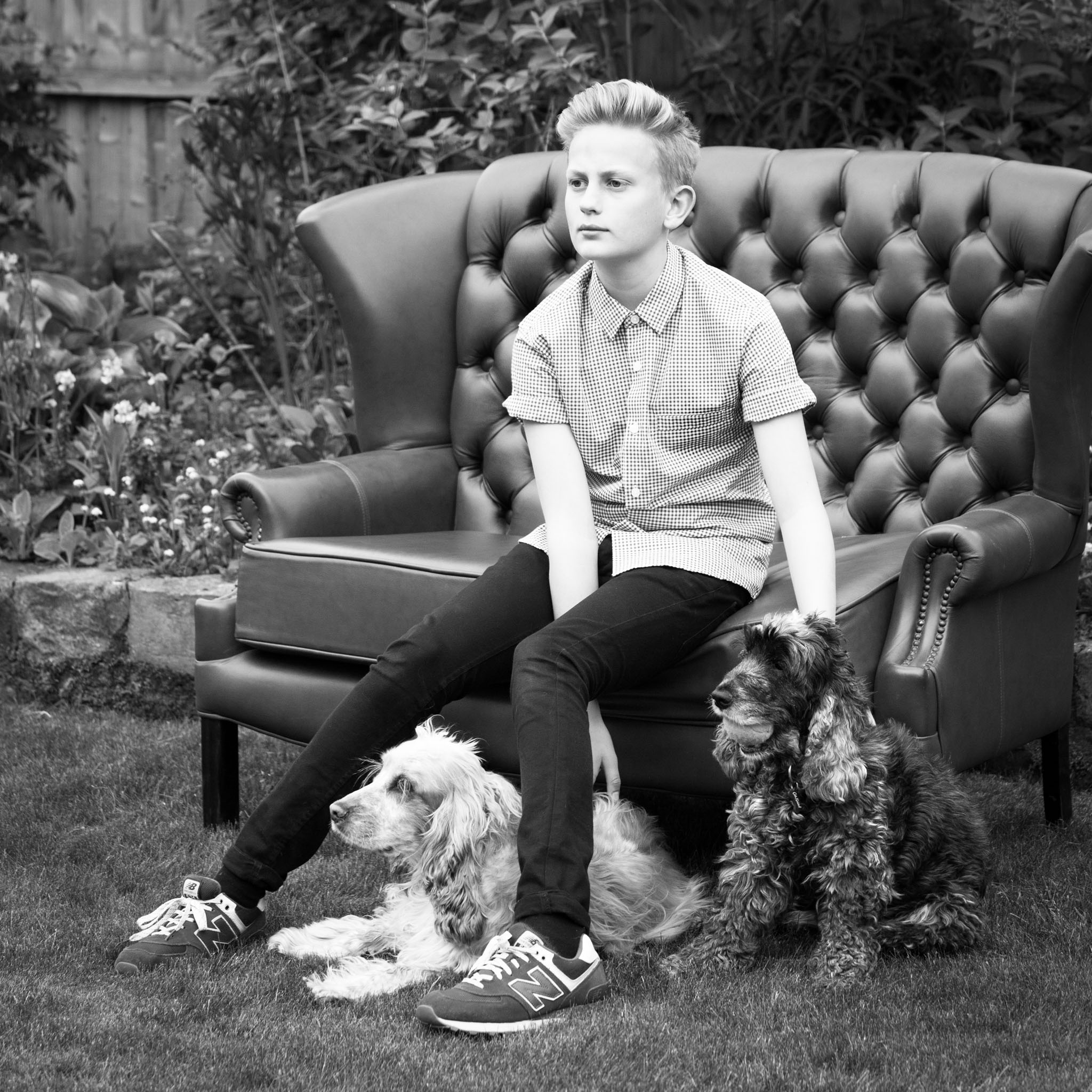 Pet portrait photography of a young man and his dogs in Appleton, Cheshire
