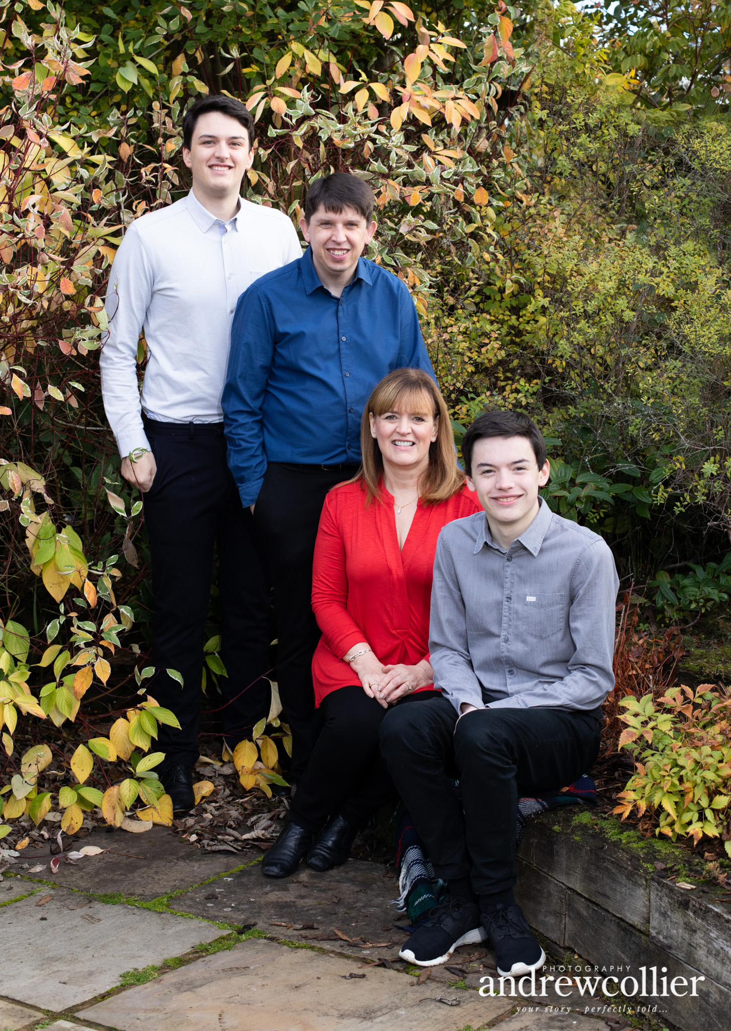 A family portrait photograph of a mother and father and two sons in Holmes Chapel, Cheshire