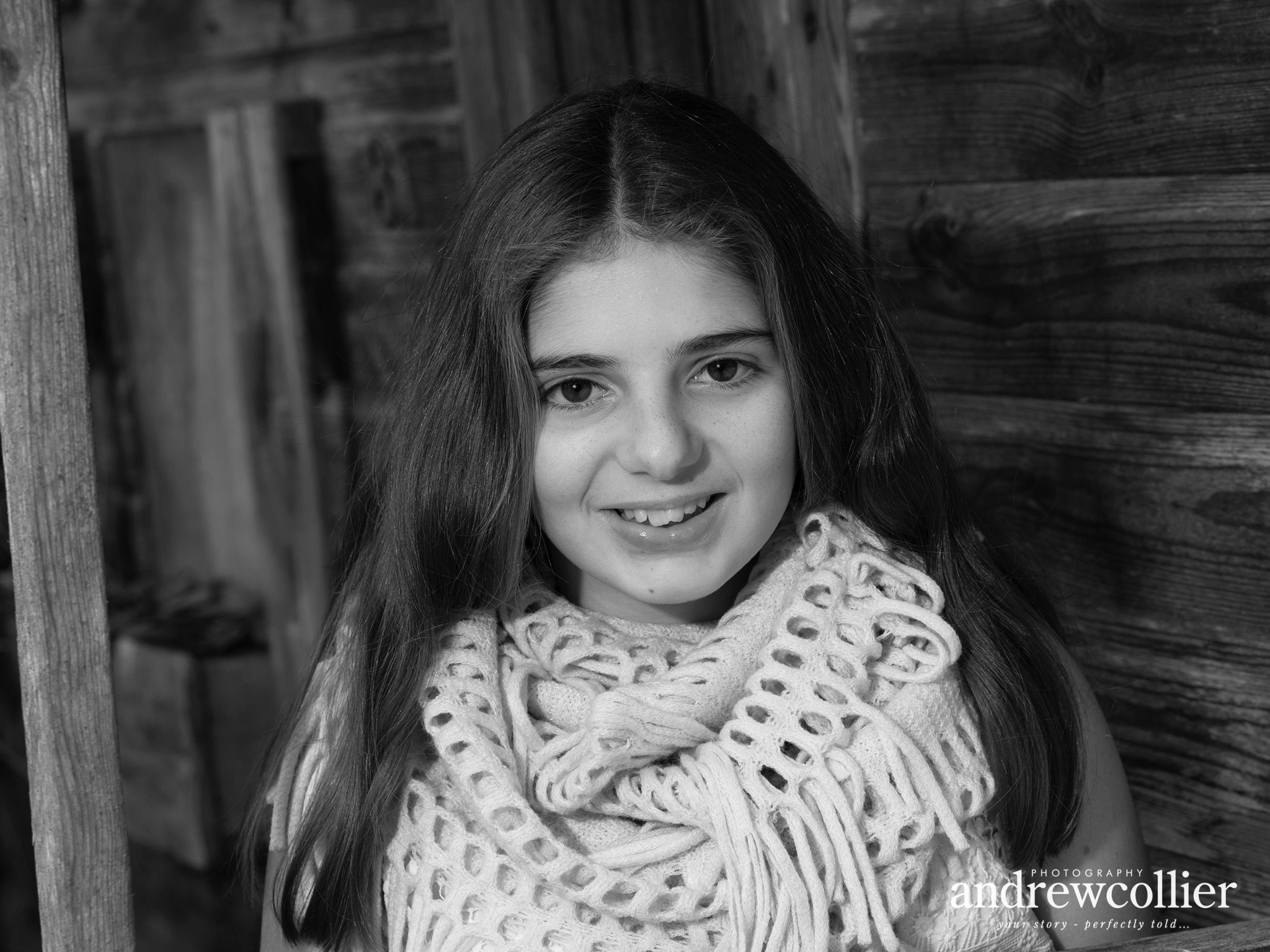 A black and white portrait of a teenaged girl wearing a scarf in Holmes Chapel, Cheshire