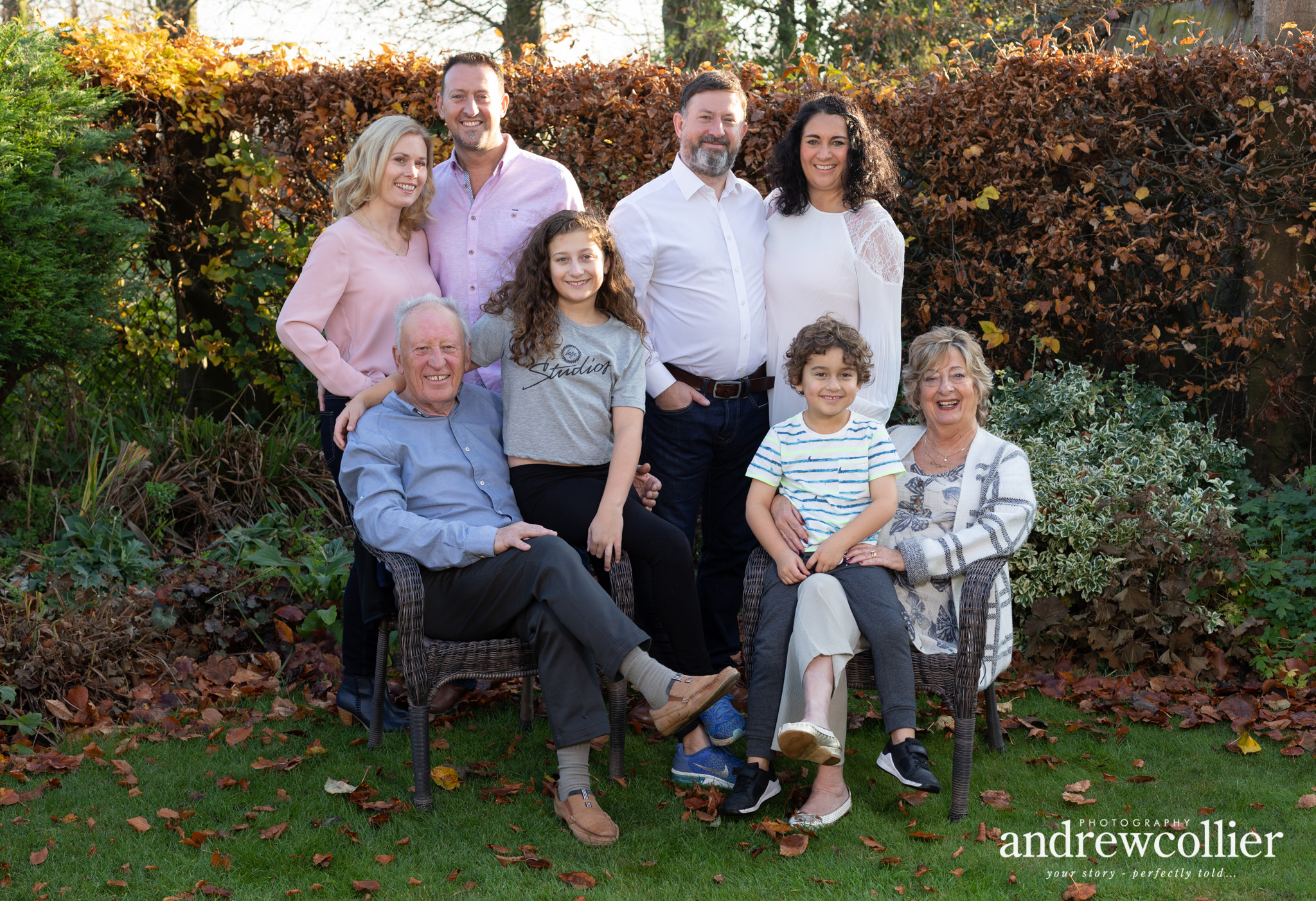 a family portrait of three generations taken in autumn sunlight in Leigh, Greater Manchester