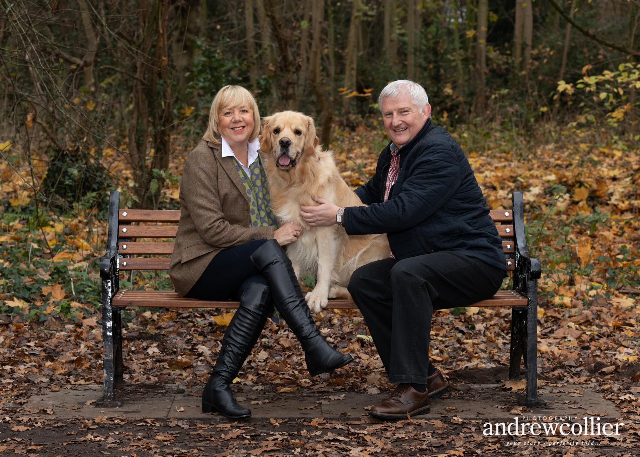 Environmental dog portrait photograph of a Golden Retriever and his owners in parkland in Chester, Cheshire