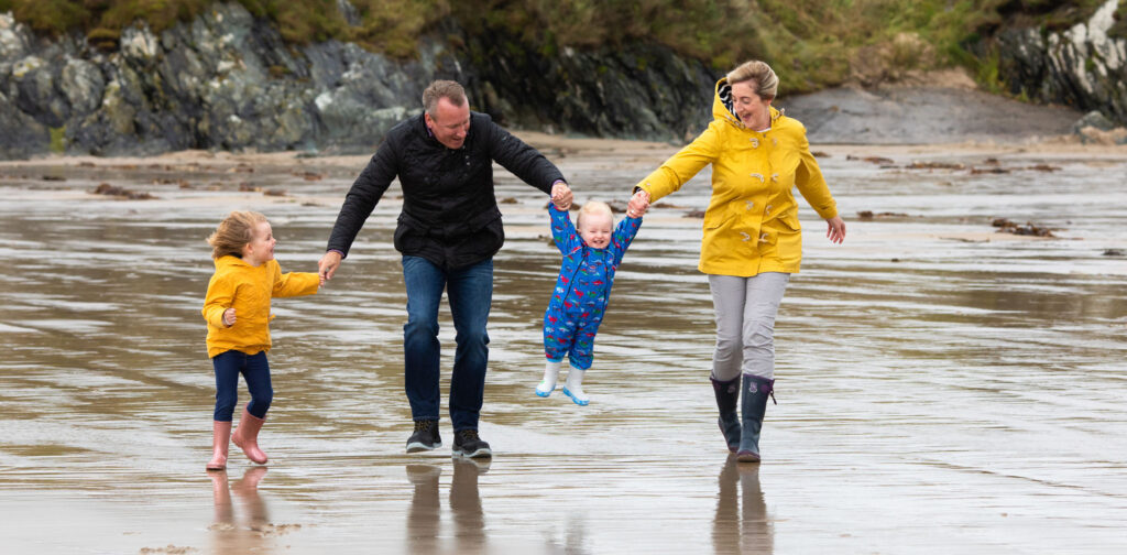 portrait photograph of a young family at the beach in Anglesey