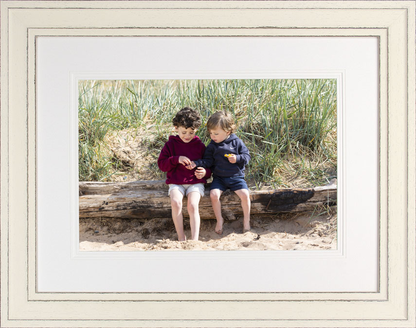 a framed collection of family portrait photography on the beach at Thurstaston, Wirral