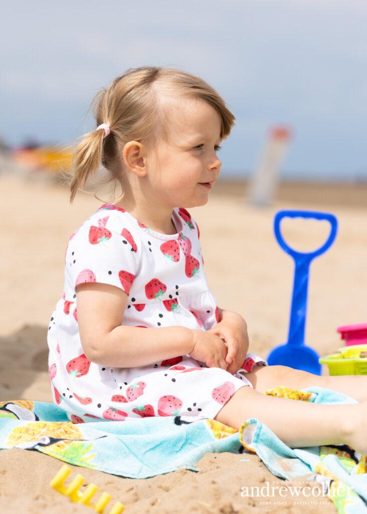 A beach portrait of a little girl at a beach, Wirral, UK