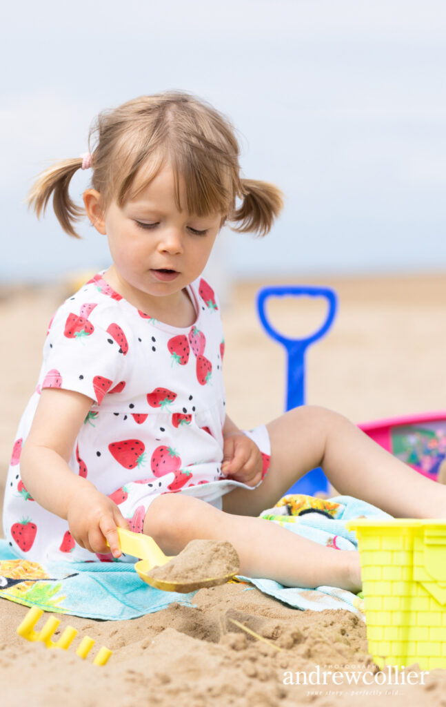 A beach portrait of a little girl at the beach, Wirral, UK