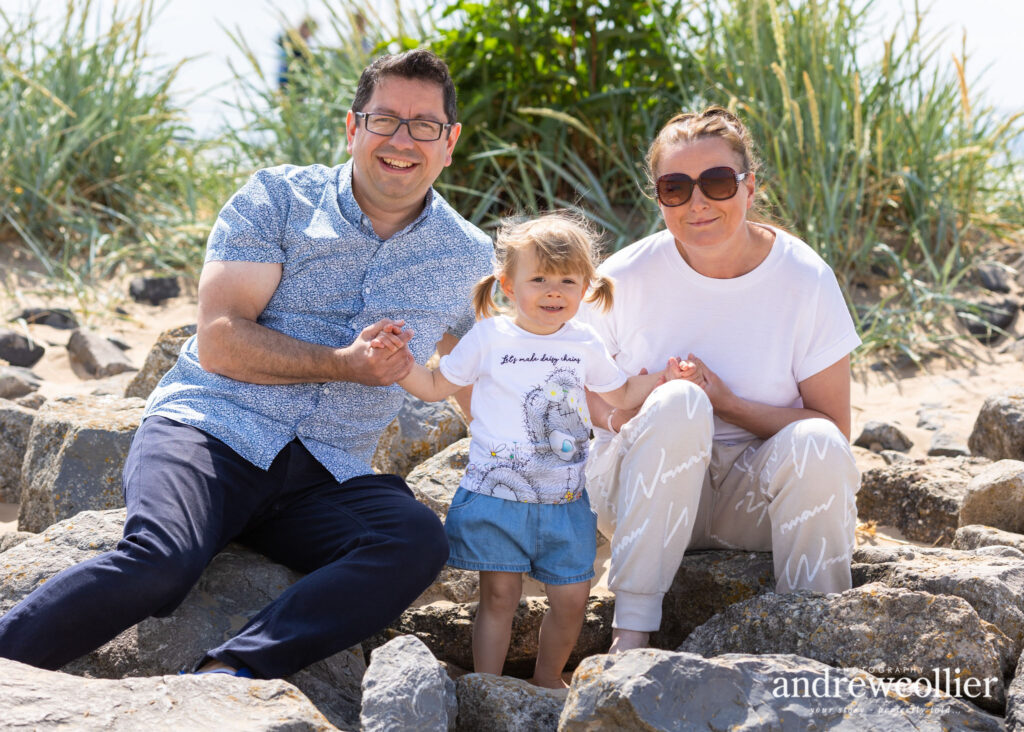 Family portrait photograph at the beach, Wirral, UK